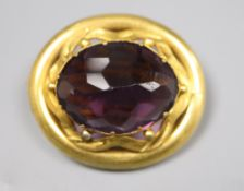 A Victorian pinchbeck and facetted amethyst paste set oval brooch, 37mm.