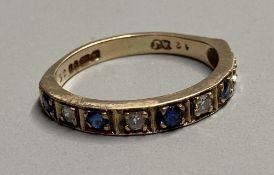 A modern 9ct gold, sapphire and diamond set nine stone half hoop ring, size L, gross 2.3 grams.