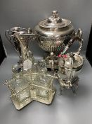 A plated samovar, a kettle on stand, a pair of vases and a three bottle silver plated tantalus and