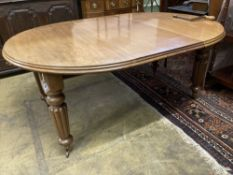 A Victorian mahogany oval extending dining table, with two spare leaves, 220cm extended, width