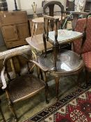 A 1920's circular caned beech occasional table, diameter 76cm, together with a pair of elbow chairs,