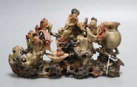 A Chinese soapstone carving of immortals, early 20th century, length 21cmCONDITION: Provenance -