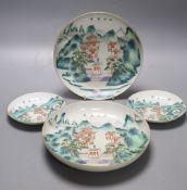 A pair of Chinese enamelled porcelain saucer dishes and two similar smaller bearing Daoguang