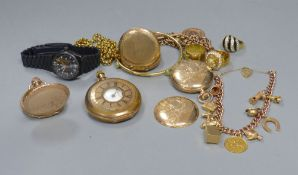 A modern 9ct gold curblink charm bracelet, hung with eleven assorted charms, including 9ct, gross 35