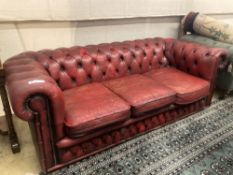 A Victorian style buttoned red leather Chesterfield settee, width 186cm depth 84cm height 66cm