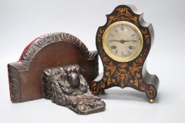 A 19th century marquetry inlaid mantel clock, height 23cm, together with a carved oak