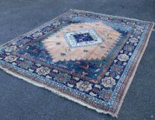 A Persian Shah-Savan carpet, 331 x 268cm