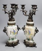 A pair of Chinese famille verte vases converted to candelabra, height 41cm