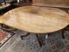 A George III oval mahogany tilt top dining table, width 158cm depth 120cm height 74cm
