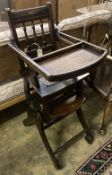 An early 20th century oak and beech child's metamorphic high chair
