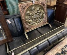 A embossed brass and copper fire screen, 70 x 70cm, together with a pierced brass fender