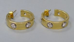 A modern pair of 18ct gold and five stone diamond set Cartier style half hoop earrings, 19mm,