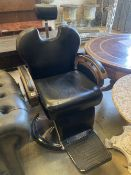 A black leatherette adjustable barber's chair, width 70cm, height 120cm