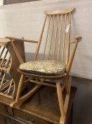 An Ercol stickback beech rocking chair