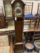 A 1930's oak cased eight day striking and chiming longcase clock, height 169cm