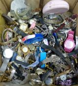 A large quantity of assorted modern lady's and gentleman's wrist watches.