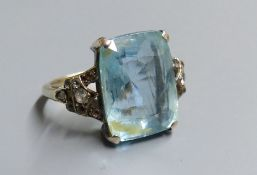 An early 20th century yellow metal, aquamarine and white stone chip set dress ring, size J, gross