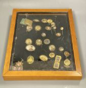 A collection of gilt metal stick pins, brooches, etc. with inset photographic miniatures in glazed