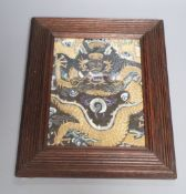 A Chinese embroidered silk and gilt wrapped thread 'dragon' panel fragment, QingCONDITION: