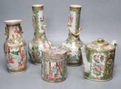 A pair of Chinese famille rose bottle vases, a similar teapot, vase and jar, 19th century, tallest