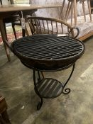 A fire pit with grill and stand, diameter 50cm height 52cm