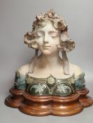 A pottery bust of a lady on a wooden stand, signed Jacobs, overall height 45cm