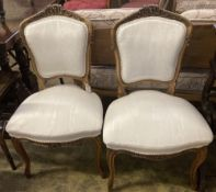 A pair of Louis XV style carved walnut side chairs