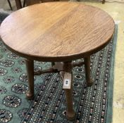 An early 20th century circular oak occasional table, diameter 50cm height 53cm