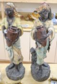 A pair of Nubian terracotta figures, height 70cm