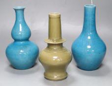 Two Chinese turquoise glazed vases and a celadon glazed bottle vase, height 20cm