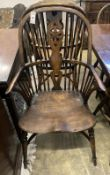 A set of ten stained ash and elm Windsor chairs with crinoline stretchers (two having arms)