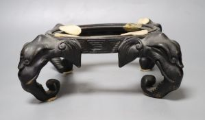 A Chinese bronze 'elephant head' stand, length 30cm