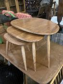 An Ercol nest of three 'Pebble' tables, width 64cm depth 42cm height 40cm