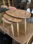 An Ercol nest of three 'Pebble' tables, width 64cm depth 42cm height 40cm