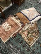 Ten Caucasian, Bokhara and North West Persian prayer mats and rugs and a Chinese mat, largest 150