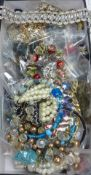 A large quantity of assorted costume jewellery.