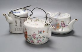 Two Chinese famille rose teapots and covers, and a calligraphic teapot, tallest 10cm