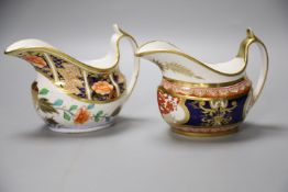 A Spode cream jug painted in imari style with the dollar pattern 715 and another Spode cream jug