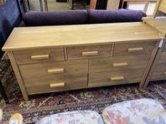 A modern contemporary oak seven-drawer chest, width 150cm, depth 45cm, height 71cm