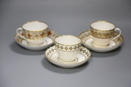 A Derby faceted teacup and saucer painted with pearls on diamond gilding pattern 135 in puce,