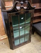 A 1920's chinoiserie lacquer hanging corner cabinet, width 66cm, depth 36cm, height 115cm