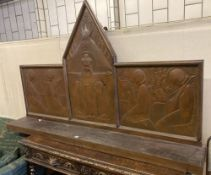 An Arts & Crafts oak and embossed copper triptych by Felix Jacques, signed and dated 1928, width