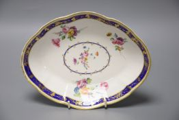 A Chelsea Derby oval dish painted with flowers in the manner of Withers under a Smith's blue and