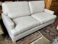 A modern contemporary two-seater sofa, length 206cm, width 102cm, height 98cm