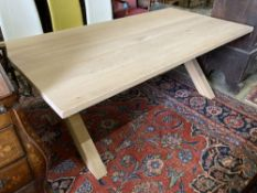 A contemporary oak X-framed dining table, length 200cm, depth 100cm, height 76cm