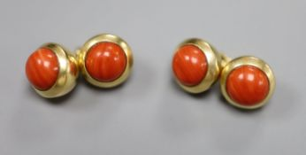 A pair of Cartier 750 yellow metal and coral bead set spherical cufflinks, signed and numbered