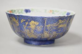 A Chinese Kangxi period porcelain bowl, the exterior glazed in powder blue with gilt tree and