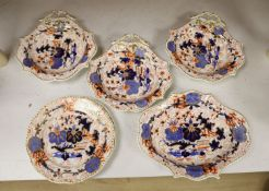 An English porcelain Imari part dessert serviceCONDITION: One dish - gilded handle glue reattached