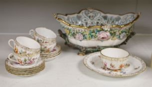 A Dresden-style pierced oval flower-encrusted bowl with 'branch' feet and handles and a Dresden part