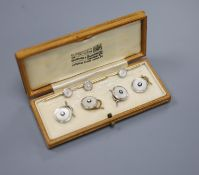 A cased set of four 1940's 18ct & Pt, mother of pearl and diamond set dress studs, gross 8.1 grams